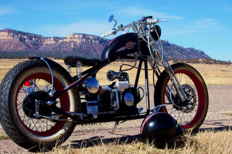 Old School Bobber Motorcycle with flat swept back bobber handlebars in the Southwest US Desert