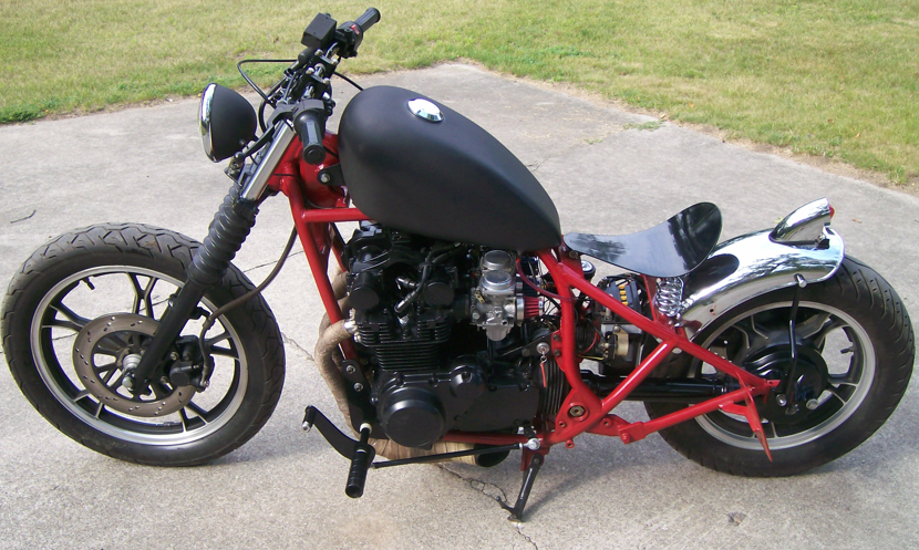 Suzuki 650 Bobber Motorcycle with Black Tank and Red Frame