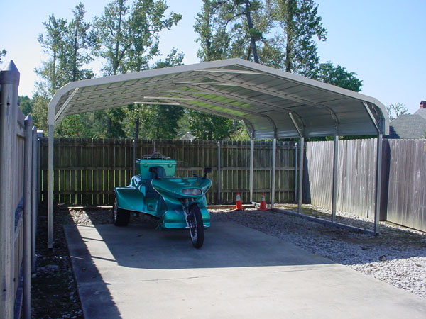 Carport with motorcycle under it