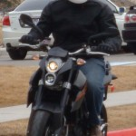 Icon Compund Motorcycle Jacket on KTM Duke 690 Supermotard